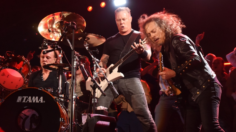 "WASHINGTON, DC - NOVEMBER 11:  (L-R) Musicians Lars Ulrich, James Hetfield and Kirk Hammett of Metallica perform onstage during ""The Concert For Valor"" at The National Mall on November 11, 2014 in Washington, DC.  (Photo by Jeff Kravitz/Getty Images for HBO)"